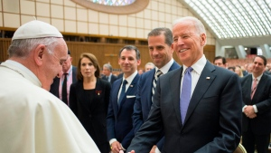 FILE - In this April 29, 2016, file photo, Pope Francis shakes hands with Vice President Joe Biden as he takes part at a congress on the progress of regenerative medicine and its cultural impact, being held in the Pope Paul VI hall at the Vatican. Biden is scheduled to meet with Pope Francis this coming Friday at the Vatican. (Pablo Martinez Monsivais/L'Osservatore Romano/Pool photo via AP)