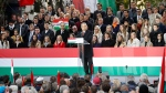 Hungarian Prime Minister Viktor Orban addresses supporters during celebration the 65th anniversary of the 1956 Hungarian revolution, in Budapest, Hungary, Saturday, Oct. 23, 2021. (AP Photo/Laszlo Balogh)