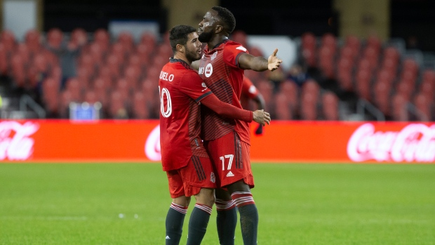 Toronto FC's Jozy Altidore (right) is congratulated by Alejandro Pozuelo, after scoring a last minute goal against CF Montreal during second half MLS action in Toronto on Saturday, October 23, 2021. THE CANADIAN PRESS/Chris Young