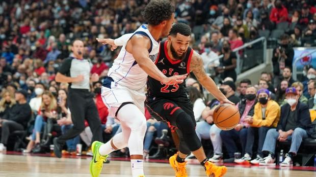 Toronto Raptors guard Fred VanVleet (23) drives to the basket against Dallas Mavericks guard Jalen Brunson (13) during first half NBA action in Toronto on Saturday, October 23, 2021. THE CANADIAN PRESS/Evan Buhler