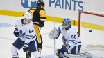 Toronto Maple Leafs' David Kampf (64) and Pittsburgh Penguins' Drew O'Connor (10) watch a puck get by Maple Leafs' Jack Campbell for a goal during the first period of an NHL hockey game Saturday, Oct. 23, 2021, in Pittsburgh, Pa. (AP Photo/Fred Vuich)