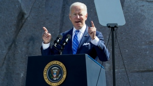 President Joe Biden speaks during an event marking the 10th anniversary of the dedication of the Martin Luther King, Jr. Memorial in Washington, Thursday, Oct. 21, 2021. The U.S. budget deficit totaled $2.77 trillion for 2021, the second highest on record but an improvement from the all-tine high of $3.13 trillion in 2020. The deficits in both years reflected trillions of dollars in government spending to counter-act the devastating effects of a global pandemic. (AP Photo/Susan Walsh)
