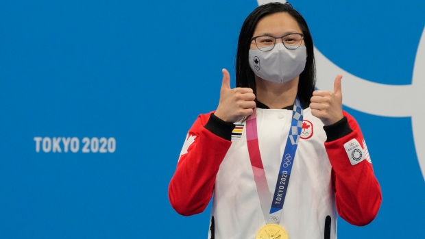 Margaret Mac Neil, of Canada, poses with the gold medal after winning the women's 100-meter butterfly at the 2020 Summer Olympics, Monday, July 26, 2021, in Tokyo, Japan. at the 2020 Summer Olympics, Monday, July 26, 2021, in Tokyo, Japan. (AP Photo/Petr David Josek)