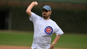 Actor James Michael Tyler throws out the ceremonial first pitch before a baseball game between the Chicago Cubs and St. Louis Cardinals Saturday, Sept. 21, 2019, in Chicago. (AP Photo/Paul Beaty)