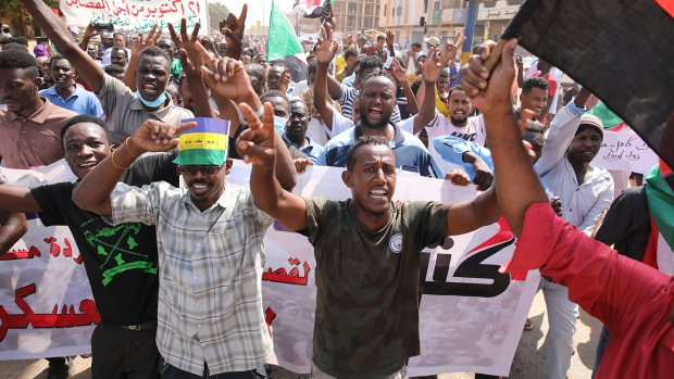 Sudanese demonstrators take to the streets of the capital Khartoum to demand the government's transition to civilian rule in Khartoum, Sudan, Thursday, Oct. 21, 2021. The relationship between military generals and Sudanese pro-democracy groups has deteriorated in recent weeks over the country's future. (AP Photo/Marwan Ali)