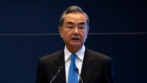 FILE - In this Oct. 20, 2021, file photo, Chinese Foreign Minister Wang Yi speaks during a promotional event for Tibet at the Ministry of Foreign Affairs in Beijing. Wang will meet with Taliban representatives during a trip this week to the Persian Gulf nation of Qatar, an official said Monday, Oct. 25, 2021. (AP Photo/Mark Schiefelbein, File)