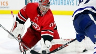 Carolina Hurricanes goaltender Frederik Andersen (31) gathers in the puck against the Toronto Maple Leafs during the third period of an NHL hockey game in Raleigh, N.C., Monday, Oct. 25, 2021. (AP Photo/Karl B DeBlaker)