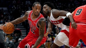 Chicago Bulls forward DeMar DeRozan (11) moves the ball around Toronto Raptors forward OG Anunoby (3) during first half NBA basketball action in Toronto, Monday, Oct. 25, 2021. THE CANADIAN PRESS/Nathan Denette