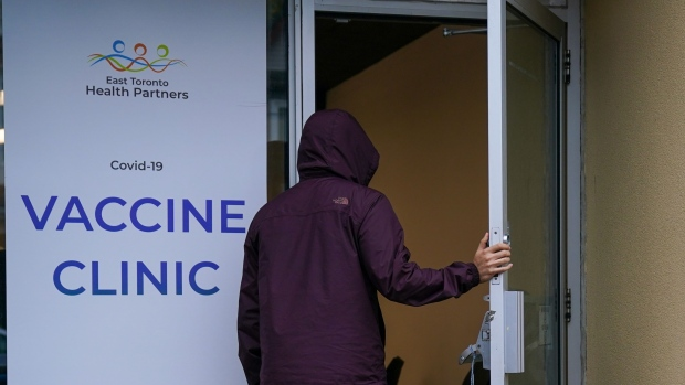 A man enters the pop-up COVID-19 vaccine clinic operated by Toronto East Health Network on Gerrard Street in Toronto on Monday, Oct. 25, 2021. THE CANADIAN PRESS/Evan Buhler