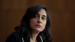 FILE- Public Services and Procurement Minister Anita Anand listens to a speaker during a news conference Monday December 14, 2020 in Ottawa. THE CANADIAN PRESS/Adrian Wyld