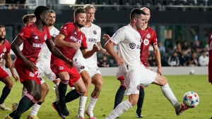 Inter Miami midfielder Lewis Morgan, right, passes the ball as Toronto FC midfielder Richie Laryea, left, and forward Jacob Shaffelburg, center, defend during the first half of an MLS soccer match, Wednesday, Oct. 20, 2021, in Fort Lauderdale, Fla. (AP Photo/Lynne Sladky)