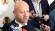In this July 26, 2019, file photo, Chicago Blackhawks senior vice president and general manager Stan Bowman speaks to the media during the NHL hockey team's convention in Chicago. Bowman resigned Tuesday, Oct. 26, 2021, following an investigation into allegations that an assistant coach sexually assaulted a player in 2010. (AP Photo/Amr Alfiky, File)