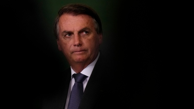 In this Oct. 25, 2021, file photo, President Jair Bolsonaro attends the launching ceremony of the National Green Growth Program at the Planalto presidential palace in Brasilia, Brazil. A Brazilian Senate committee will vote Tuesday, Oct. 26, on a report recommending Bolsonaro face a series of criminal indictments for actions that allegedly added to the world's second-highest COVID-19 death toll. (AP Photo/Eraldo Peres, File)
