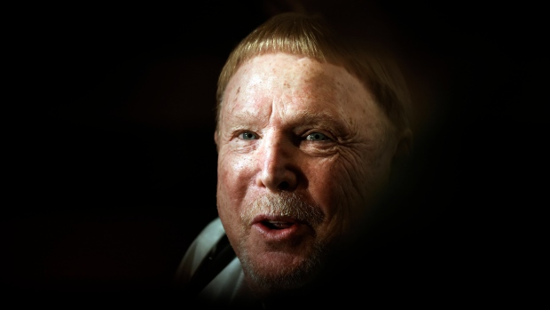 Mark Davis, owner of the Las Vegas Raiders, talks to reporters as he leaves the NFL owners meeting in New York, Wednesday, Oct. 27, 2021. (AP Photo/Adam Hunger)