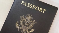 """FILE - This May 25, 2021 file photo shows a U.S. Passport cover in Washington. The United States has issued its first passport with an """"X"""" gender designation, a milestone in the recognition of the rights of people who don't identify as male or female. (AP Photo/Eileen Putman)"""