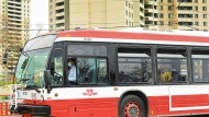 A TTC bus transports people in a neighbourhood that Ontario has designated a postal code hotspot during the COVID-19 pandemic in Toronto on Monday, May 3, 2021. THE CANADIAN PRESS/Nathan Denette