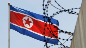 FILE - North Korean flag flutters behind razor wire on top of a wall at North Korean Embassy in Kuala Lumpur, Malaysia, Monday, March 13, 2017. (AP Photo/Vincent Thian)