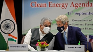 """FILE- In this Sept.13, 2021 file photo, Indian Environment Minister Bhupender Yadav, left and U.S. Special Presidential Envoy for Climate John Kerry talk during the launch of Climate Action and Finance Mobilisation Dialogue (CAFMD) under India-US Agenda 2030 Partnership in New Delhi, India. Rich countries needed to take their """"historical responsibility"""" in a serious manner, while ensuring that the interests of developing countries and those vulnerable to climate change must be assured, said Yadav at a press briefing in New Delhi on Wednesday, Oct.27, 2021 . (AP Photo/Manish Swarup, File)"""