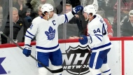 Toronto Maple Leafs' John Tavares, left, celebrates his goal with Morgan Rielly during the second period of an NHL hockey game against the Chicago Blackhawks Wednesday, Oct. 27, 2021, in Chicago. (AP Photo/Charles Rex Arbogast)