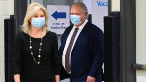 Ontario Premier Doug Ford, right, and Mississauga mayor Bonnie Crombie tour a mass COVID-19 vaccination clinic for Peel Region during the COVID-19 pandemic in Mississauga, Ont., on Monday, March 1, 2021. THE CANADIAN PRESS/Nathan Denette
