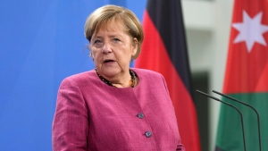 German Acting Chancellor Angela Merkel addresses the media during a joint statement with King Abdullah II of Jordan prior to a meeting at the Chancellery in Berlin, Germany, Wednesday, Oct. 27, 2021. (AP Photo/Michael Sohn, Pool)