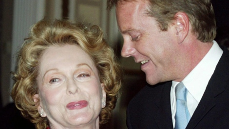 Performer and social activist Shirley Douglas is congratulated by her son and actor Kiefer Sutherland after she was invested as Officer to the Order of Canada in Ottawa, Friday October 24, 2003. (THE CANADIAN PRESS/Fred Chartrand)