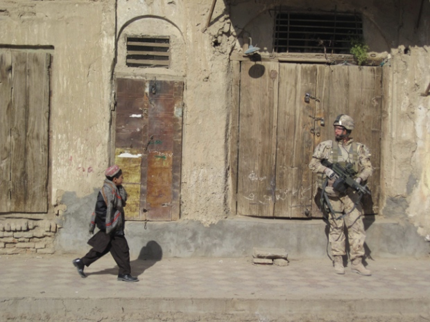 A Canadian soldier patrols Kandahar city during Eid celebrations, Afghanistan, Nov. 27, 2009. (Jonathan Montpetit / THE CANADIAN PRESS)