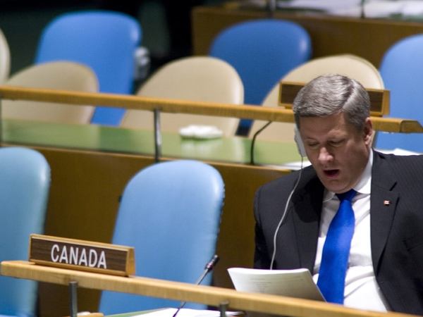 Canadian Prime Minjister Stephen Harper yawns as he waits to deliver his speech at the United Nations 61st General Assembly, in New York City Thursday Sept. 21, 2006. (THE CANADIAN PRESS / Tom Hanson)