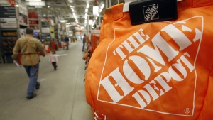 Shoppers walk through the aisles at the Home Depot store in Williston, Vt. on Monday, Feb. 22, 2010. (AP / Toby Talbot)