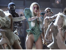 Lady Gaga, center, performs at the Grammy Awards on Sunday, Jan. 31, 2010, in Los Angeles. (AP / Matt Sayles
