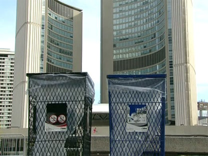 A recycling and garbage bin sit in front of the city hall in downtown Toronto, Monday, April 26, 2010.