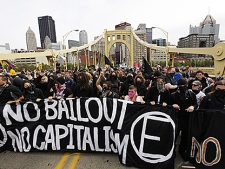 Protesters at last year's G20 meeting march across the 7th Street Bridge in Pittsburgh, Friday Sept. 25, 2009. (AP Photo/Matt Rourke)