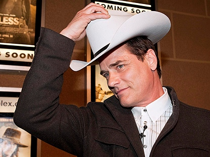 "Actor Paul Gross, puts on the White Hat he was presented with by Calgary Mayor Dave Bronconnier, before the premiere of Gross' move ""Gunless"" in Calgary, Tuesday, April 20, 2010. Gunless opens in theatres April 30.(THE CANADIAN PRESS/Jeff McIntosh)"