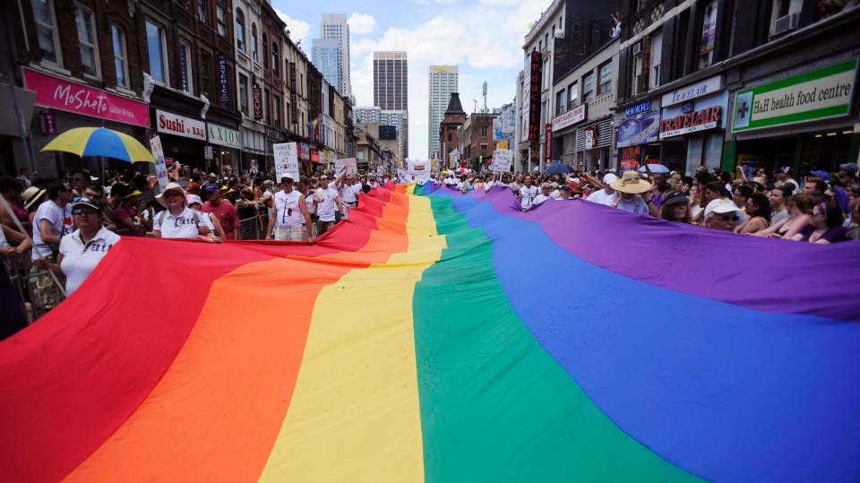 People take part in the annual Pride Parade in Toronto on Sunday, July 3, 2011. (THE CANADIAN PRESS)