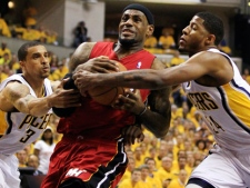 Miami Heat's LeBron James, center, goes to the basket against Indiana Pacers' George Hill (3) and Paul George, right, during the first half of Game 3 of their NBA basketball Eastern Conference semifinal playoff series on Thursday, May 17, 2012, in Indianapolis. (AP Photo/Darron Cummings)