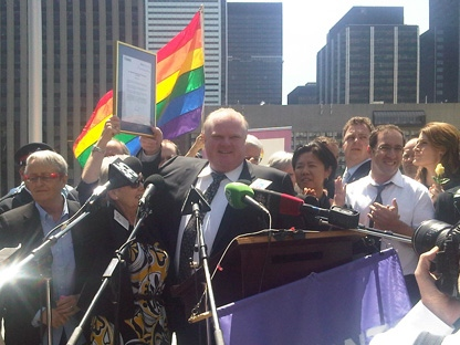Toronto Mayor Rob Ford joins fellow city council members and PFLAG representatives during a rainbow flag-raising event for the International Day Against Homophobia and Transphobia at city hall Thursday, May 17, 2012. (CP24/Farah Nasser)