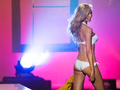 Jenna Talackova, the first transgender Miss Universe contestant, is seen on stage during the preliminary round of the Miss Universe Canada contest in Toronto on Thursday, May 17, 2012. (THE CANADIAN PRESS/Aaron Vincent Elkaim)