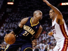 Indiana Pacers' David West (21) drives to the basket as Miami Heat's Shane Battier (31) defends during the first half of Game 5 of the NBA basketball Eastern Conference semifinal playoff series, in Miami on Tuesday, May 22, 2012. (AP Photo/Lynne Sladky)
