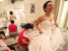 In this April 8, 2010 photo, Jessica Vega tries on the wedding gown at Bella Coutre, in Newburg, N.Y.(AP/Times Herald-Record, Jeff Goulding)