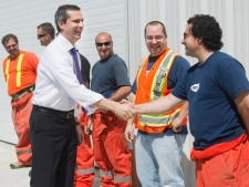 Ontario Premier Dalton McGuinty, left, shakes hands with Highway 407 ETR workers in Woodbridge, Ont., on Thursday, May 24, 2012, before announcing the Highway 407 East Project in Durham Region, which will create 900 direct construction jobs and help commuters get to work faster with the expansion of Highway 407. (THE CANADIAN PRESS/Nathan Denette)