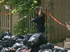 Police investigate after a severed human torso was found in Montreal on Tuesday, May 29, 2012.