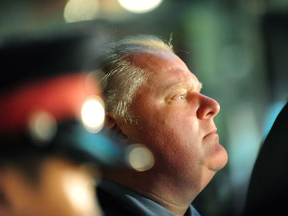 Toronto Mayor Rob Ford watches the activity outside the Eaton Centre in Toronto, Saturday, June 2, 2012. A shooting that sparked mass panic at Toronto's Eaton Centre killed one person Saturday and injured seven others. THE CANADIAN PRESS/Victor Biro