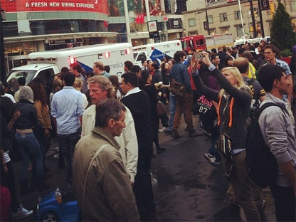 Hundreds of people stand outside the Eaton Centre on June 2, 2012 following a shooting inside the mall. (Twitter)