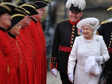Britain's Queen Elizabeth II, right, arrives at Chelsea Pier in London before boarding the royal barge to participate in the Diamond Jubilee River Pageant on Sunday, June 3, 2012. (AP Photo/Bethany Clarke, Pool)