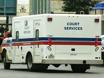 A court services vehicle is pictured outside 52 Division. (CTV)