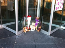 A small memorial is pictured outside Eaton Centre on Monday, June 4, 2012, after a man was killed and others were wounded in a shooting in the mall's food court two days earlier. (CTV/Tamara Cherry)