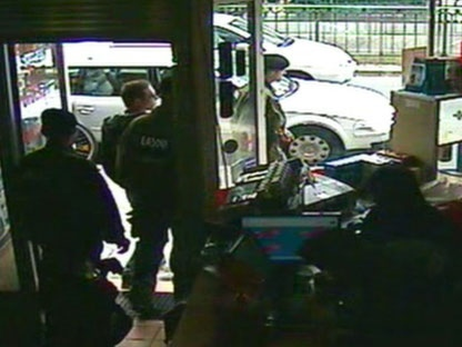 This image taken from CCTV obtained by Associated Press video shows Luka Rocco Magnotta, 2nd left, being removed by police from the Internet cafe in the district of Neukoelln in Berlin, Germany, on Monday, June 4, 2012. (AP Photo/AP Video)