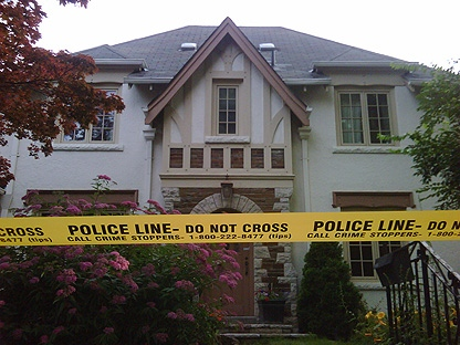 Police tape surrounds the home of a man charged in connection with a G20 investigation. (CP24/Mathew Reid)