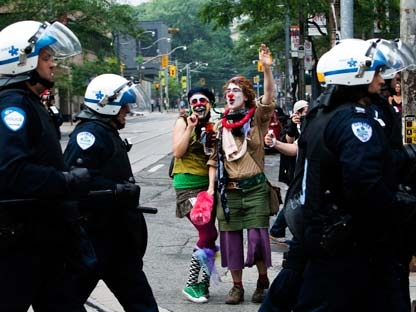 Activists and protesters heckle riot police while marching along the streets of downtown Toronto during the G20 Summit on Saturday, June 26, 2010. (Nathan Denette/THE CANADIAN PRESS)