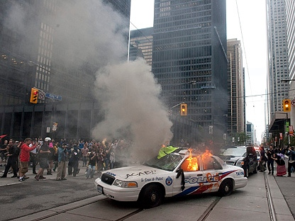 A police car burns after G20 summit protesters set fire to it in downtown Toronto on Saturday, June 26, 2010. (THE CANADIAN PRESS/Chris Young)